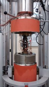 Triaxial Cell with Acoustic Emission Sensors attached to a Jacketed Sample. © Portsmouth University